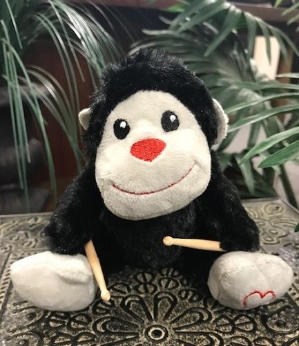 gorilla with drumsticks